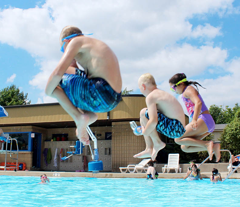 Kids do cannonballs into Lions Club Pool during the summer of 2016. Park district commissioners are wrestling with whether to open the pool this year as the COVID-19 pandemic continues to complicate operations. (Chronicle file photo)