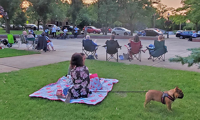 Listeners gather in lawn chairs and blankets to listen to The Park Sessions band, led by Sam Calhoon. (Eric Crump/H-F Chronicle)