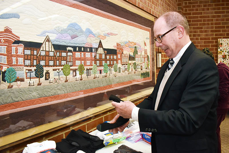 Flossmoor Mayor Paul Braun packs new socks at Flossmoor village hall as part of MLK Day of Service activities in January 2020. (Chronicle file photo)