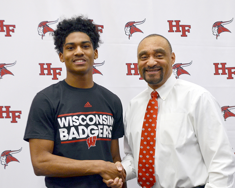 Homewood-Flossmoor High School Superintendent Von Mansfield, an alumnus of the University of Wisconsin, congratulates H-F athlete Kendric Pryor who was accepted at the university. (Provided photo)