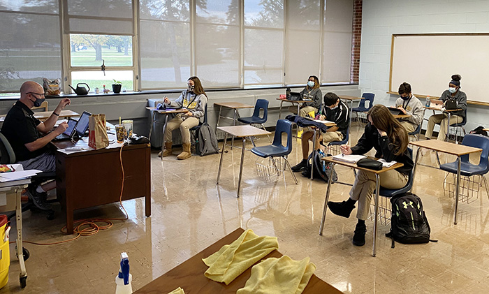 Marian Catholic High teacher Scott Becvar teaches trigonometry to students in class and those joining remotely. Surfaces are cleaned after each class. (Provided photo)