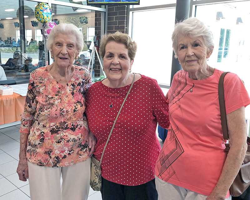 Mary Cantway welcomes friends Jane Robinson, center, and Pat Boysen, right, to her 105th birthday celebration at the H-F Racquet & Fitness Club.