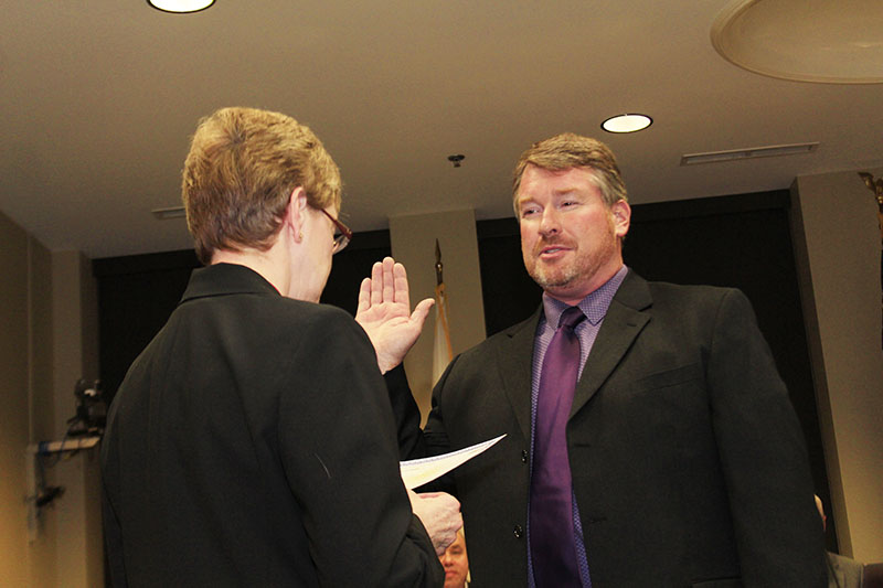 Patrick McAneny takes   the oath of office Dec. 12   after being hired as   Homewood's assistant   public works director. (Eric Crump/H-F Chronicle)