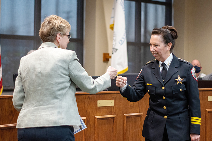 Homewood Village Clerk Marilyn Thomas fist bumps with Homewood Police Chief Denise McGrath after administering the oath to the new chief. (Andrew Burke-Stevenson/H-F Chronicle)