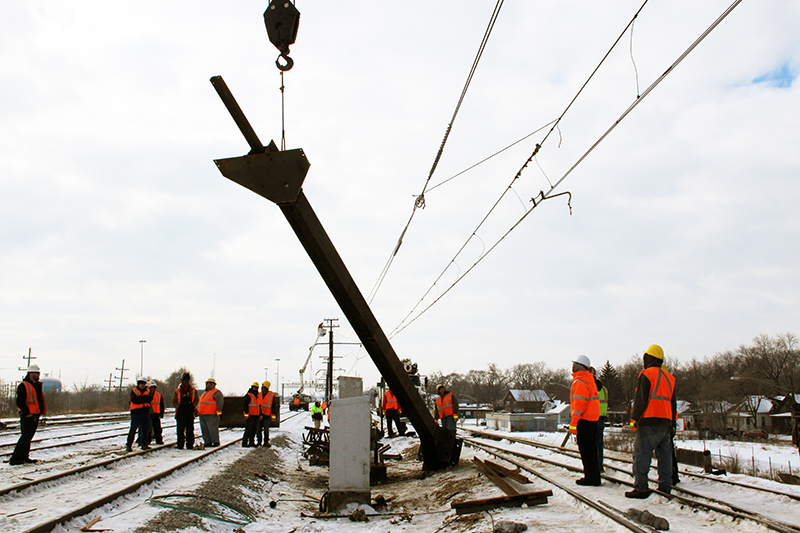 A crane was used to upright and remove the damaged support structure on the Metra tracks near Harvey. (Provided photos)