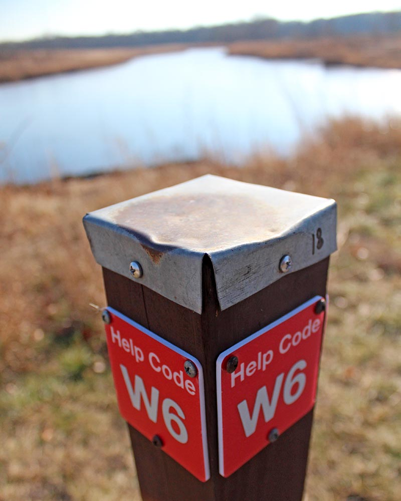 One of the new emergency markers at Izaak Walton Nature Preserve shows the numeric and directional designation designed to help first responders quickly locate an emergency situation.