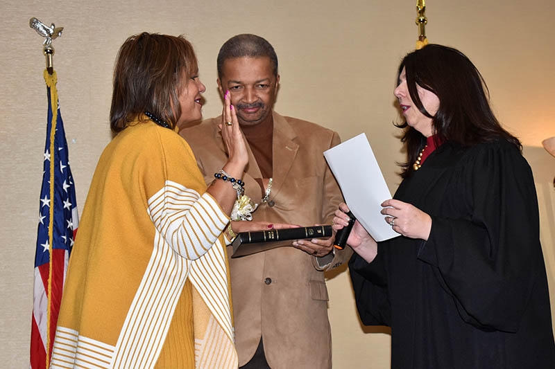 Congresswoman Robin L. Kelly is sworn in as representative for the 2nd Congressional District of Illinois. The oath of office is administered by the Honorable Anna Demacopoulos. Holding the bible is Kelly's husband, Dr. Nathaniel Horn. (Mary Compton/H-F Chronicle)