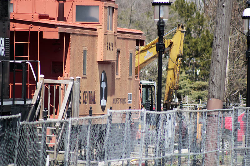 Workers have installed fencing around the Homewood Railroad Park in order to prepare the site for a new parking lot, part of the extensive renovation of the train station. (Eric Crump/H-F Chronicle)