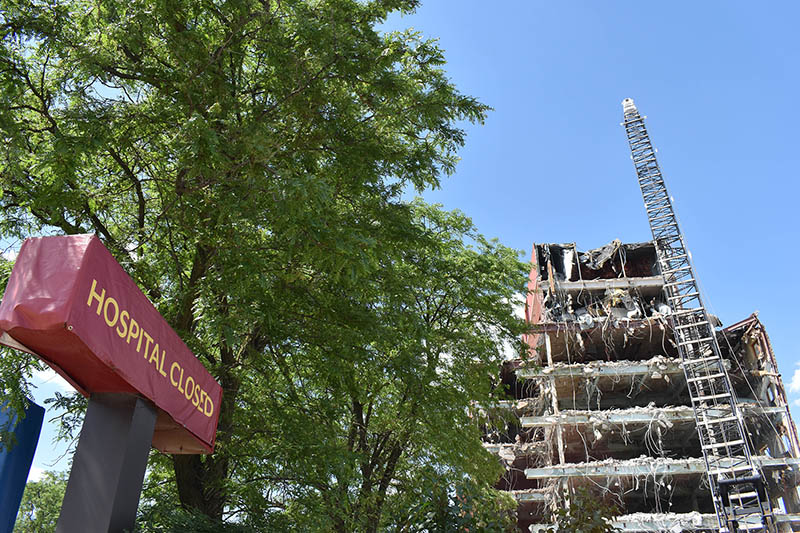 The demolition of the former St. James Hospital at 1423 Chicago Road in Chicago Heights proceeds on June 11. The hospital, owned by Franciscan Health, closed in September 2018. Franciscan recently expanded its Olympia Fields campus about 5 1/2 miles from the Chicago Heights location. (Mary Compton/H-F Chronicle)