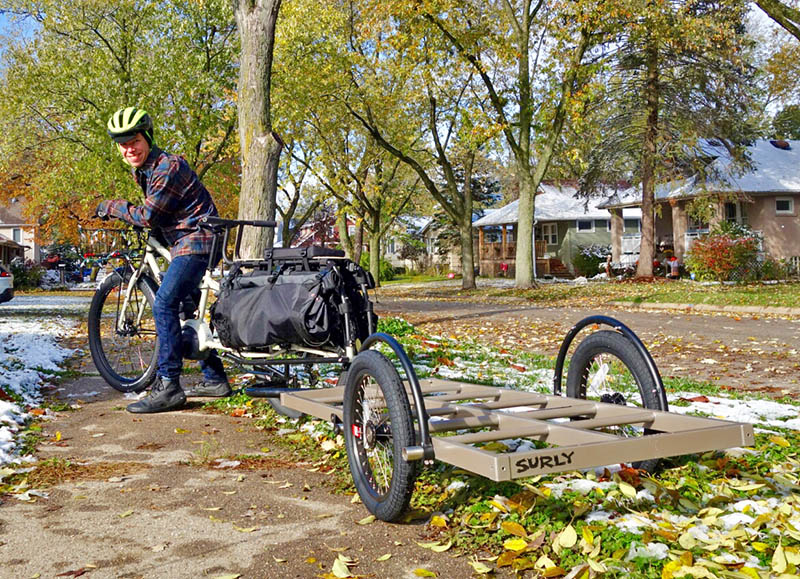 Steve Buchtel of GoodSpeed Cycle shows the e-bike and trailer he plans to use to deliver Christmas trees for the Cancer Support Center. GoodSpeed will donate the delivery fees back to the center. (Provided photo)