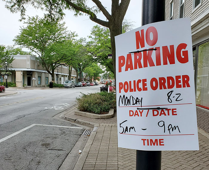 No parking signs are posted along Ridge Road in preparation for filming to take place in Homewood on Monday. (Eric Crump/H-F Chronicle)