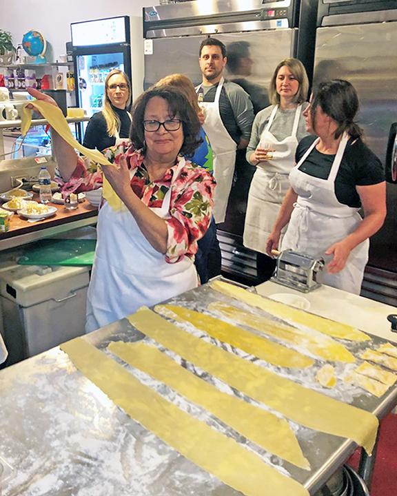 Tina Coleman diplays her pasta dough at the Dunning's Market cooking class. (Danielle Maya Banks/H-F Chronicle)