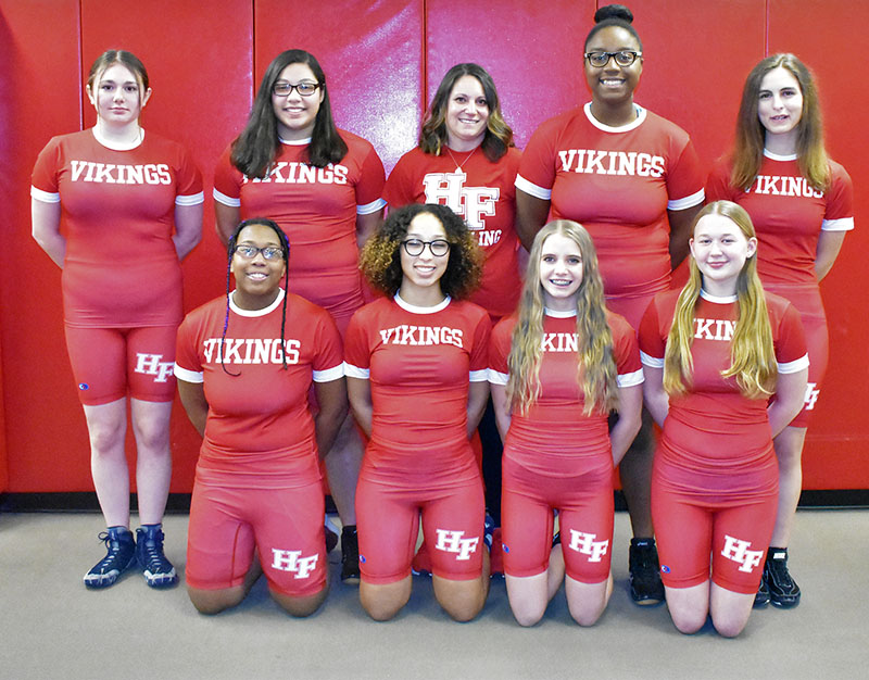 Members of the Homewood-Flossmoor High girls wrestling team are, front row, from left, Stacy Norris, Kris Moore, Diana Martin, Maddy Skowronski and, back row from left, Abby Krakar, Fernanda Vazquez, Coach Jen Olumstad, Jayda Phillips and Savannah Holly.‬ (Donald Crocker/H-F Chronicle)