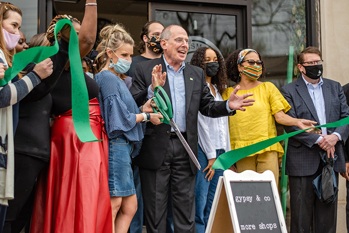 Flossmoor Mayor Paul Braun helps Morgan Sullins, holding the scissors, celebrate the grand opening of Gypsy & Company in downtown Flossmoor on April 10. (Chronicle file photo)