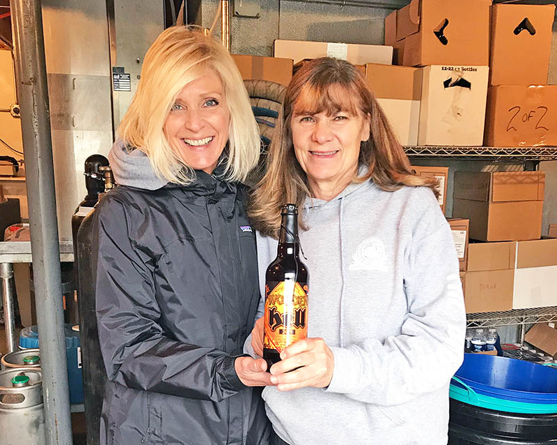 The first photo is of Sandi Nelson, general manager, on left and owner Carolyn Armstrong on the right, with a bottle of their limited-release Wooden Hell Barley Wine Barrel-Aged Beer. (Carrie Steinweg/H-F Chronicle)