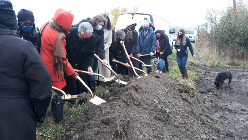 Alongside some furry friends, officials ceremoniously shovel dirt at the construction site for a new South Suburban Humane Society Facility in Matteson on Oct. 27, 2020. (David P. Funk/H-F Chronicle)