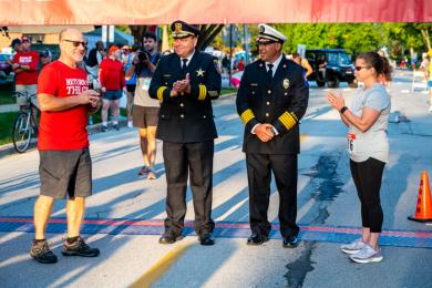 From left, Hidden Gem organizer Tom Dobrez asks Flossmoor Police Chief Tod Kamleiter, Fire Chief Bob Kopec and Mayor Michelle Nelson to accept the 9/11 memorial garden from the race organization. (ABS)