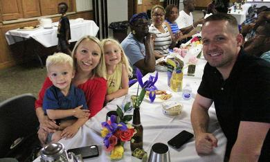 The Swart family of Homewood, from left, Kepler, Stacey, Lincoln and Craig, enjoy the community picnic at Irwin Center.