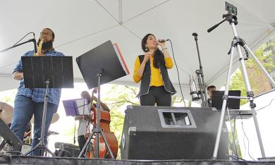 Music on Saturday begin in lingering drizzle as Subhi performed a fusion of Hindi tradtional music, Bollywood show tunes and Chicago jazz.