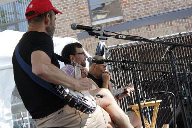 Local band Work in Progress perform Americana and classic rock and blues.