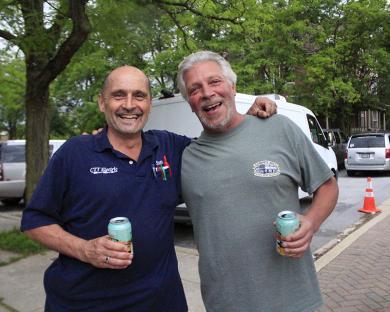 Scott Sliwinski, left, and Ed Borger enjoy the music and fine summer evening at the Artisan Street Fair.