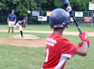 Bryce Gilmore throws a pitch during Flossmoor Baseball's Bronco championship game. (BJ))