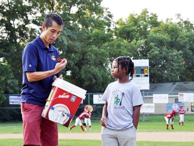 Ashton Rowe helps Bronco League Commissioner James Cheung pull tickets for the raffle before the start of the championship game. (BJ)
