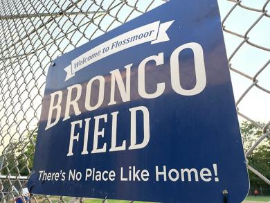 A sign welcomes players and spectators alike to Bronco Field for the championship game. (BJ)