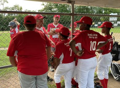 Head coach Pete Williams and team manager Tom Sullivan talk to the Phillies at the start of the championship game. (BJ)
