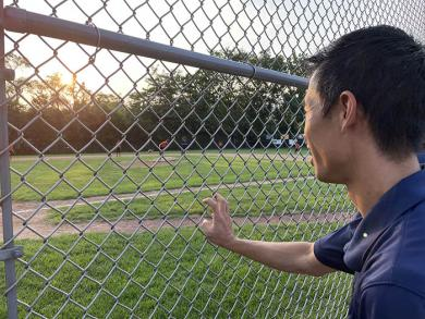 Bronco League Commissioner James Cheung takes in some of the action of the third-place game. (BJ)