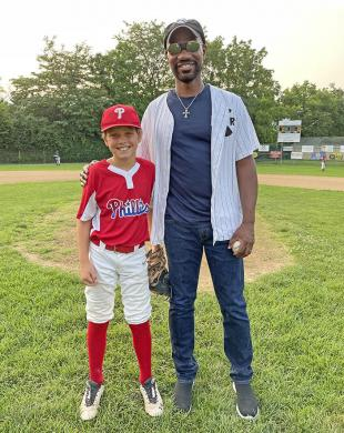 Green Velvet poses for a photo with the Phillies' Brady Williams, who served as the catcher for the first pitch. (BJ)