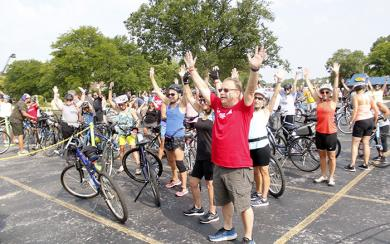 Cyclists raise their arms for a group photo prior to the start of Bike the Gem on Saturday in Flossmoor. (EC)