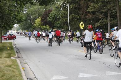 Cyclists head west on Flossmoor Road at the start of Bike the Gem. (EC)
