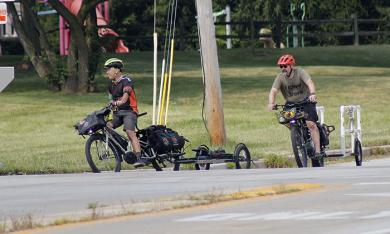 The GoodSpeed Cycle crew, Steve Buchtel, left, and Chris Bednarik, cruise the race route to help cyclists with any mechanical problems. (EC)