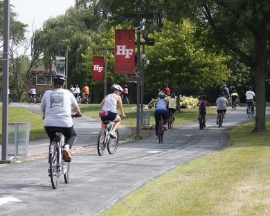 Cyclists head through the H-F High campus. (EC)