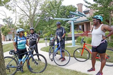 From left, Laurie Flowers, Gia Roberts, Derrick Small and Blenda Robertson stop in front of Flossmoor library to compare notes on the ride. (EC)