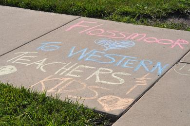 The community left messages outside Western Avenue Elementary School sending its love to returning students and teachers. (BJ)