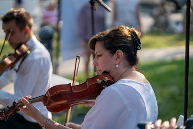 Kristen Wiersma plays violin with the Illinois Philharmonic Orchestra String Quartet on Wednesday, Aug. 18, in front of the Flossmoor Public Library during Chamber Night. (BC)