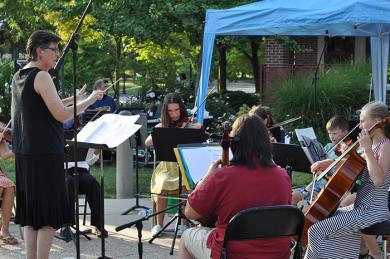 The Homewood Flossmoor Suzuki Summer Strings Orchestra performs Aug. 18 during the first portion of the inaugural Chamber Night in downtown Flossmoor. (BJ)