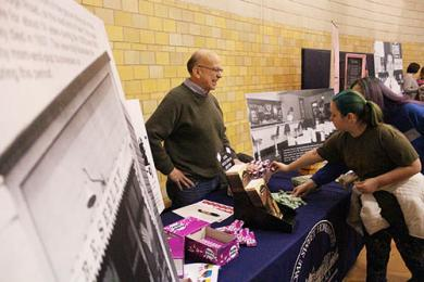 Jim Wright, representing the Homewood Historical Society, talks with Chocolate Festival patrons as they help themselves to free candy from the era when Homewood was incorporated 125 years ago. (EC)