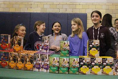 Girl Scouts from Troop No. 60540 sell cookies during Chocolate Fest, from left, Noelle Holt, Grace Barry, Macy Hamer, Olivia Lewandowski and Cyanna Wasniowski. (EC)