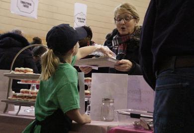 Kammi Nelson serves a Chocolate Fest visitor.