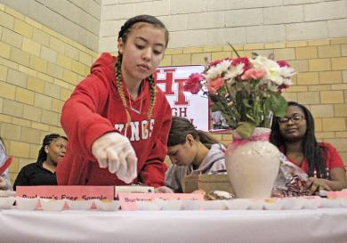 Belinda Gutierrez replenishes samples of buckeyes, a peanut-butter and chocolate treat prepared by the Homewood-Flossmoor High School advanced culinary class.