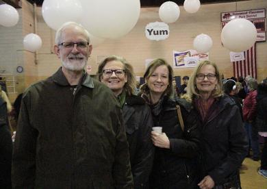 From left, Mark Leschuck of Homewood; Lisa Leschuck of Cheyenne, Wyoming; Polly Landgraf of Detroit, Michigan; and Susan Wassman of Naperville pose for a photo. The three women said they were visiting their hometown of Homewood for the chocolate — and to see brother Mark.