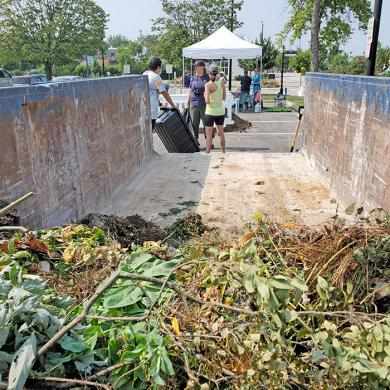 A dumpster was available at the composting event to collect organic material brought by visitors. (EC)