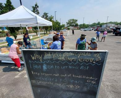 A chalkboard at the Homewood composting event invited visitors to write messages saying what they planned to do with their compost. (EC)