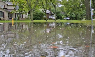 The intersection of Perth Avenue and Heather Road in Flossmoor is flooded following storms the morning of Aug. 18. (Eric Crump/H-F Chronicle)