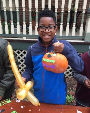 Johjuan Gardner shows off his decorated pumpkin at Homewood's Fall Fest. Children got the chance to select and decorate pumpkins.