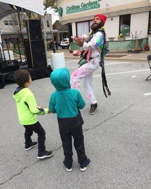 Keaton Fisher, a flow artist, had a fun time to youngsters at Fall Fest as he demonstrated his juggling tricks.