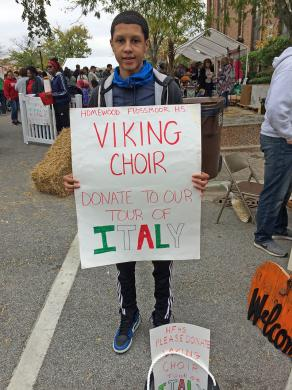 The sign told the story: Najee Jones of Homewood-Flossmoor High School was collecting money at Fall Fest to help defray the expense of the upcoming Master Singers trip to Italy.